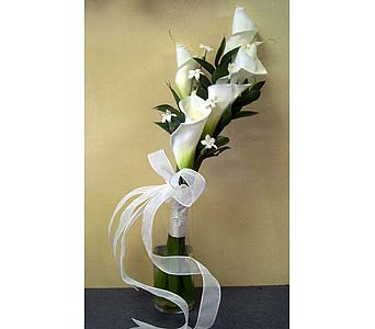 Calla Lilies and StephanotisPlease call for more info 888-279-7845 in Manotick ON, Manotick Florists