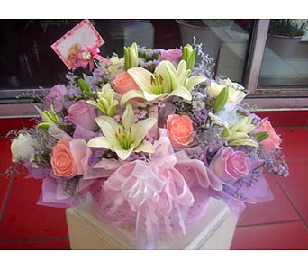 1Dz Lily Basket with Statice in Rowland Heights CA, Charming Flowers