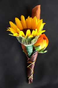 Sunflower & Ranunculus Boutonniere in Portland ME, Dodge The Florist