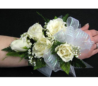 WHITE SPRAY ROSE WRISTLETPlease call for pricing in New Paltz NY, The Colonial Flower Shop