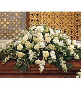 Pure White Casket Spray in Hartland WI, The Flower Garden