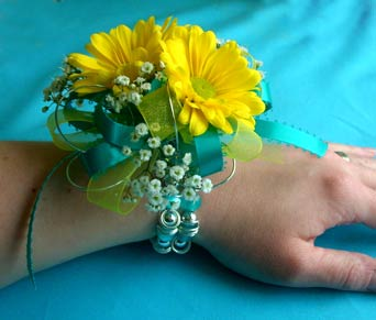 Turquoise & Yellow Daisy Wrist Corsage in Portland ME, Dodge The Florist