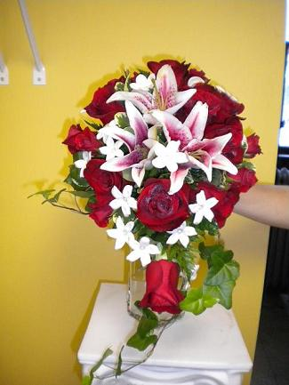 Cascading bridal bouquet in Bensenville IL, The Village Flower Shop