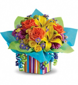 Teleflora's Rainbow Present in Houston TX, Village Greenery & Flowers