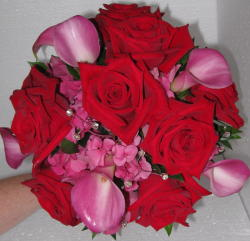 Vibrant Callas and Roses Clutch in Waukegan IL, Larsen Florist