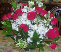 White Stock and Red Rose Clutch in Waukegan IL, Larsen Florist