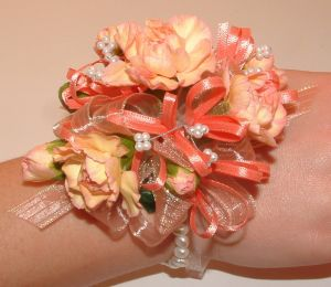 Peach Mini Carnation Wristlet in Salisbury MD, Kitty's Flowers