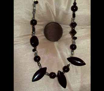 Simple Glamorous Black Necklace in Lawrence KS, Englewood Florist