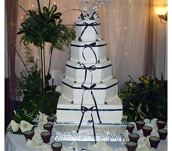 WHITE WEDDING CAKE WITH CHOCOLATE ACCENTS in Hanover PA, Country Manor Florist