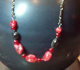Red Crackle Glass Necklace in Lawrence KS, Englewood Florist