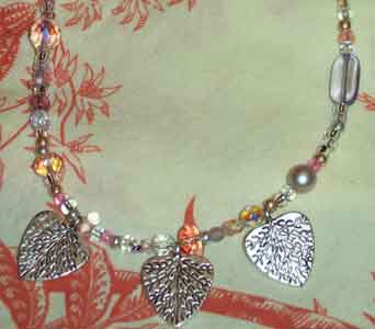 Light Pink Necklace with Three Heart Charms in Lawrence KS, Englewood Florist