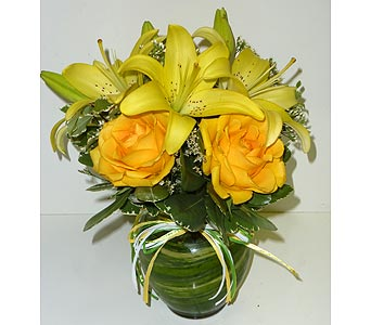 Yellow Passion in Raleigh NC, Gingerbread House Florist - Raleigh NC