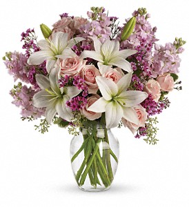 Teleflora's Blossoming Romance in Mount Morris MI, June's Floral Company & Fruit Bouquets