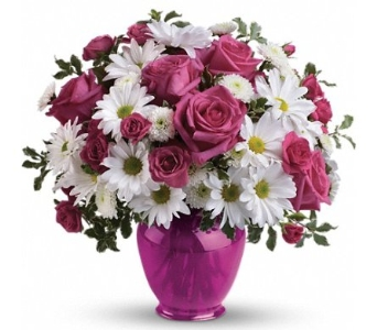 The charming bouquet includes pink spray roses and white daisy spray chrysanthemums accented with fresh greenery. Delivered in a fuchsia ginger jar vase. From Plaza Flowers, your King of Prussia Florist.