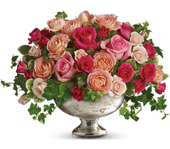 Light, medium and hot pink roses and spray roses are hand-arranged with greens in a gorgeous Mercury Glass Bowl. It's perfectly majestic! From Plaza Flowers, your King of Prussia Florist.