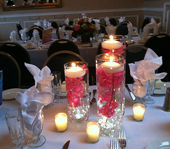Pink Orchid Candles in Staten Island NY, Sam Gregorio's Florist
