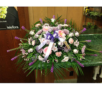 Pastel Tribute Casket Spray in Dorchester MA, Lopez The Florist
