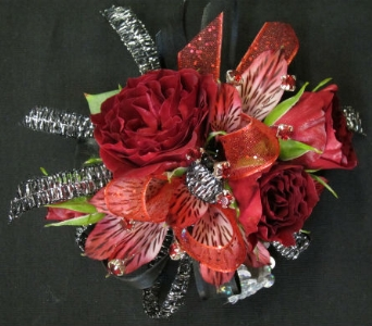 Red Roses and silver accent in Lawrence KS, Owens Flower Shop Inc.