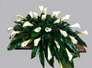 Peaceful Callas Casket Spray in Lake Charles LA, A Daisy A Day Flowers & Gifts, Inc.