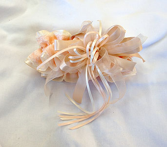 Hand made peach garter in Hales Corners WI, Barb's Green House Florist