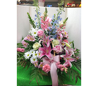 Pastel Wicker Basket in Manhasset NY, Town & Country Flowers
