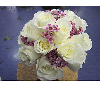 Handwrapped white rose bouquet with a touch of purple wax flowers in Statesville NC, Brookdale Florist, LLC