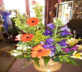 Fresh Spring Mix in Wicker Basket in Milford OH, Jay's Florist