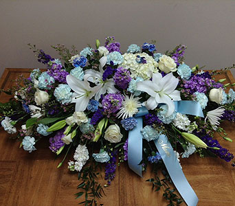Blue Harmony Casket Spray in Brownsburg IN, Queen Anne's Lace Flowers & Gifts