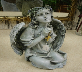 Praying angel with cross in ionia mi sid 39 s flower shop for Praying angel plant