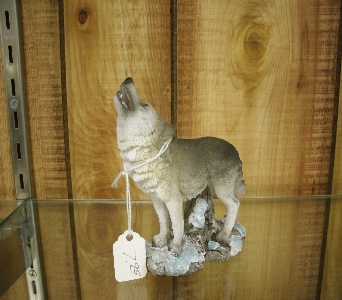 Small Grey Wolf Figurine in Ionia MI, Sid's Flower Shop
