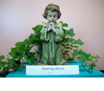 Kneeling Cherub in Bellefonte PA, A Flower Basket