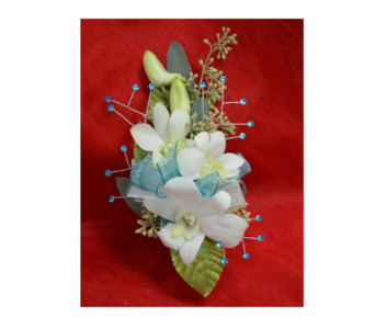 Orchid and Turquoise Corsage in Easton MD, Robin's Nest