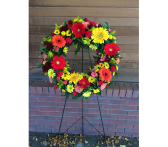 Vibrant Sympathy Wreath in Longmont CO, Longmont Florist, Inc.