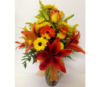 Burst of Fall Arrangement - Tulip Vase - One-Sided in Wyoming MI, Wyoming Stuyvesant Floral