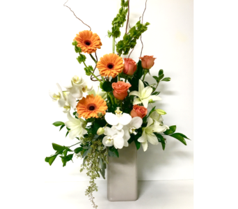 Orchids and Orange Ceramic Vase Arrangement in Wyoming MI, Wyoming Stuyvesant Floral