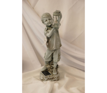 Little boy statue with solar light in Hales Corners WI, Barb's Green House Florist
