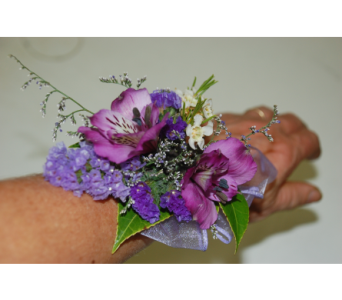 Purple passion wristlet in Scarborough ON, Helen Blakey Flowers