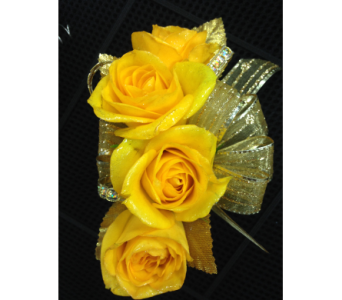 Yellow spray rose wrist corsage  in Gainesville FL, Floral Expressions Florist