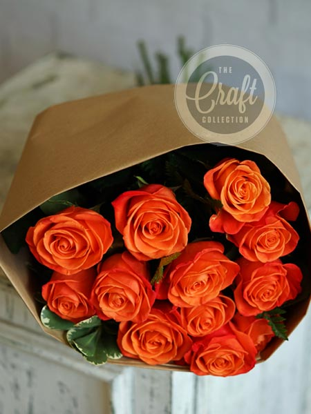 Wrapped Roses in Orange in Raleigh NC, Fallon's Flowers