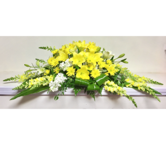 Yellow Remembrance Casket Spray in Wyoming MI, Wyoming Stuyvesant Floral