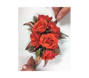 Coral and Copper Corsage in Clearwater FL, Hassell Florist