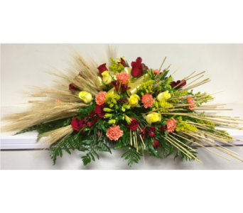 Sheaf of Wheat with Bright Colors Casket Spray in Wyoming MI, Wyoming Stuyvesant Floral