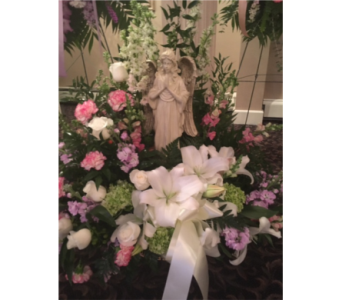 Angel in Grotto in Staten Island NY, Kitty's and Family Florist Inc.