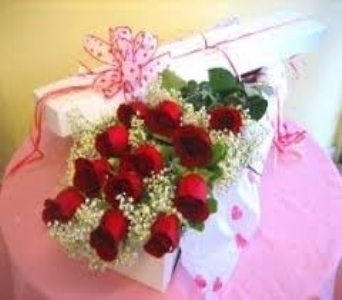 A dozen roses boxed with Baby�s Breath & Green in North Bay ON, The Flower Garden