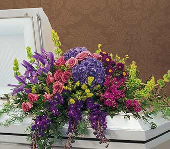 Graceful Tribute Casket Spray in Port St Lucie FL, Flowers By Susan