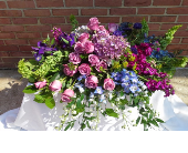 Purple garden casket spray in Ellicott City, Maryland, The Flower Basket, Ltd