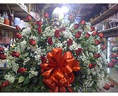 STANDING BASKET OF ROSES WITH STATUE in Staten Island NY, Eltingville Florist Inc.
