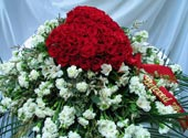 RED ROSE HEART CASKET SPRAY by Rubrums in Ossining NY, Rubrums Florist Ltd.
