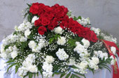RED ROSE CROSS CASKET SPRAY by Rubrums in Ossining NY, Rubrums Florist Ltd.