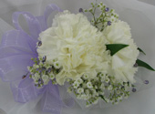 WHITE CARNATION CORSAGE W/ GEMS in Ossining NY, Rubrums Florist Ltd.